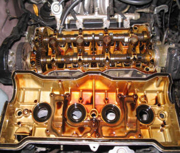 Geo Prizm engine with valve cover removed after 239,000 miles using ONLY AMSOIL products